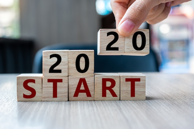 2020 start word on table background. resolution, strategy, solution
