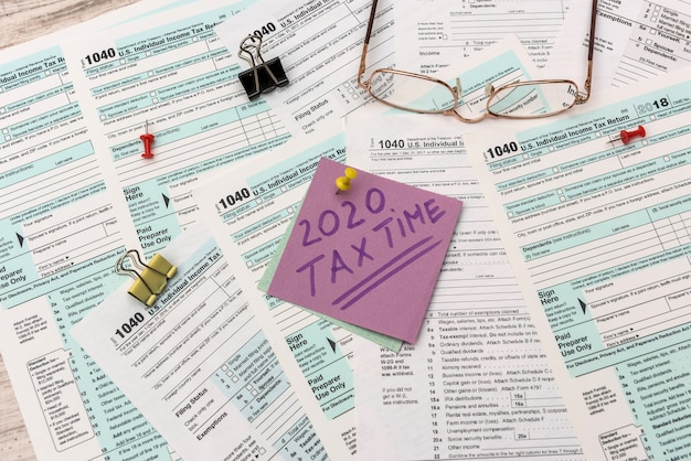 2020 tax company stickers with reminder at 1040 tax form close up