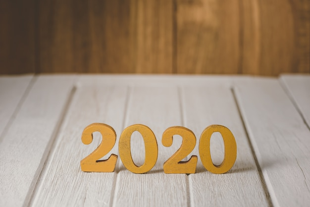 2020 wooden gold number.  happy new year on nature concept