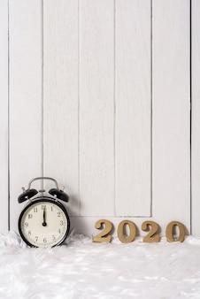 2020 wooden text on white fur