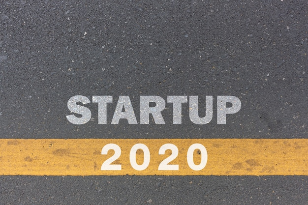 2020 year and business concept.  startup message or words print on the road background