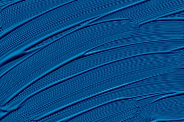 2020年の古典的な青の流行色。ブラシストロークで抽象芸術の背景。モノクロカラーテクスチャ。