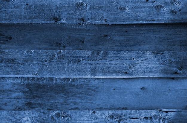 Синяя текстура древесины с естественными узорами. классический синий цвет. цвет 2020 года. модный цвет.