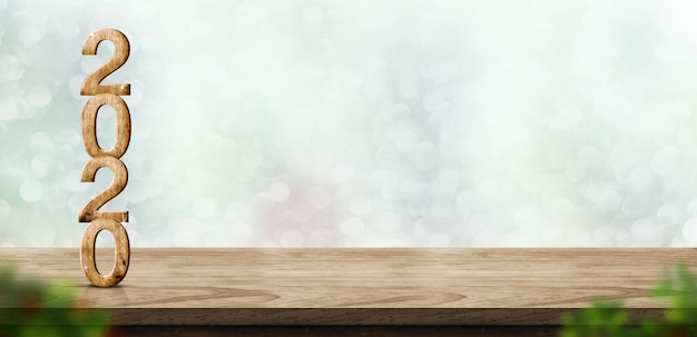 木製テーブルの上の新しい年2020年木材番号ぼかし抽象的な緑ボケ背景