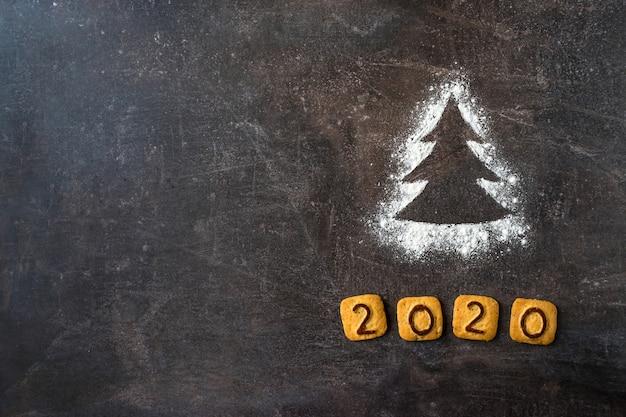 Мука силуэт елки с 2020 номер печенье фон
