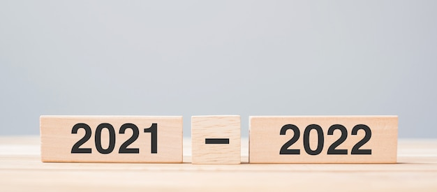 2021 and 2022 wooden block on table background. resolution, strategy, countdown, goal, change and new year holiday concepts