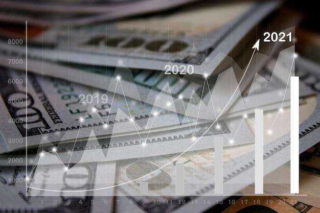 2021.仮想ホログラム統計、グラフで紙幣のお金の背景の斜視図を閉じます。ビジネスと金融の概念、世界経済。抽象的なテクスチャ背景。セレクティブフォーカス。
