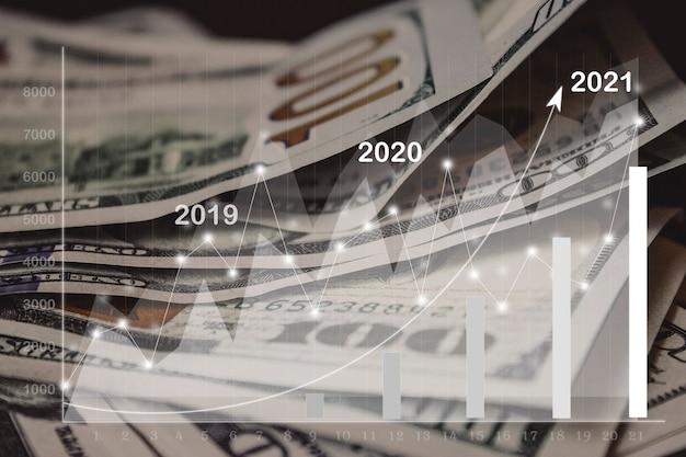 2021仮想ホログラム統計グラフマネーで背景として紙幣の斜視図をクローズアップ