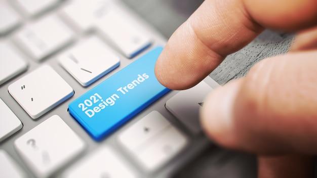 Тенденции дизайна 2021 года - металлическая клавиатура с синей клавишей. 3d визуализация.