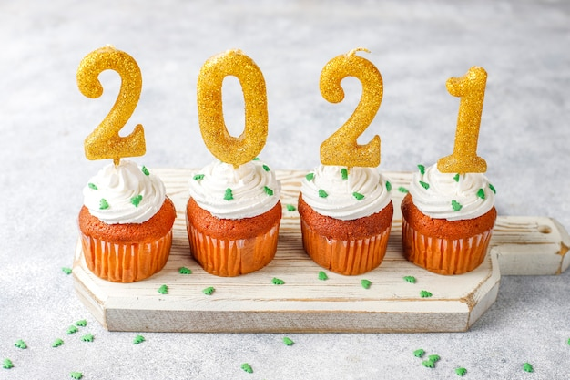 2021 golden candles on cupcakes