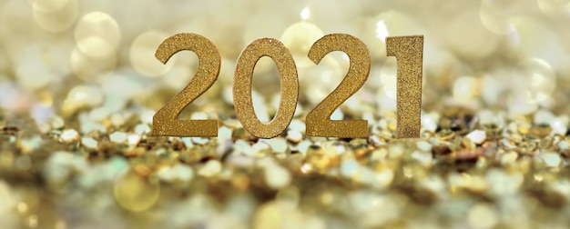 2021 golden number on abstract golden confeti