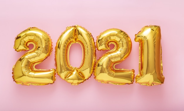 2021 happy new year gold air balloons text on pink background. long web banner.