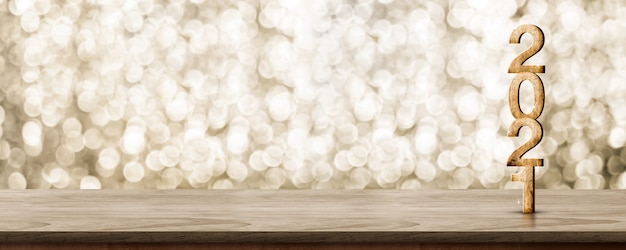Деревянное число с новым годом 2021 (3d-рендеринг) на деревянном столе со сверкающей золотой стеной боке
