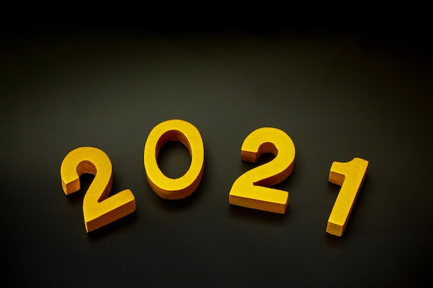 2021 made of wood and gold painted on black background