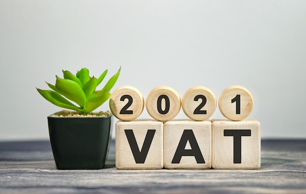 2021 vat financial concept on wooden cubes and flower in a pot