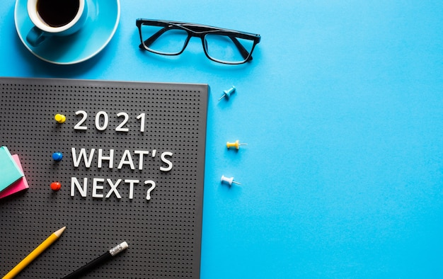 2021 what's next ? text on work table.trends research and new things.business startup concepts