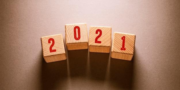 2021 word written on wooden cubes