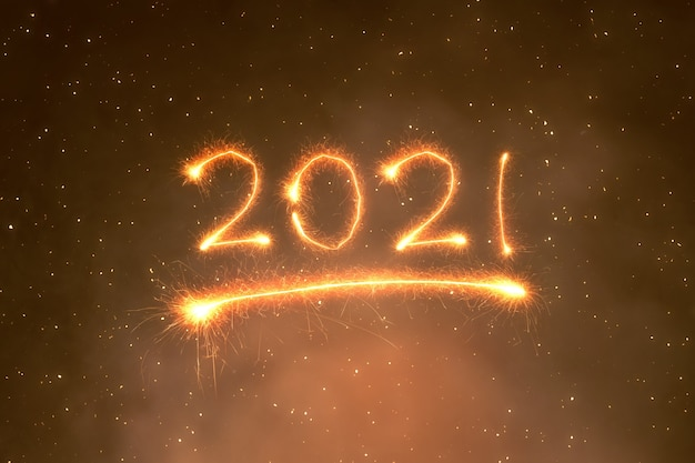 2021 written sparkles with a bright background. happy new year 2021