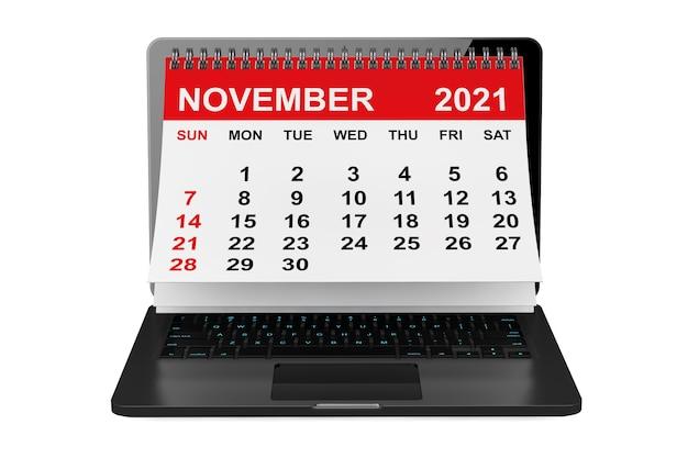 2021年のカレンダー。白い背景の上のノートパソコンの画面上の11月のカレンダー。 3dレンダリング