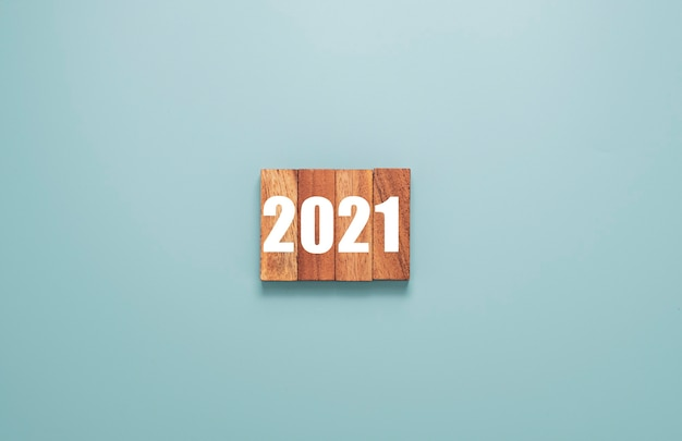 2021year printed on wooden cubes block. merry christmas and happy new year concept.