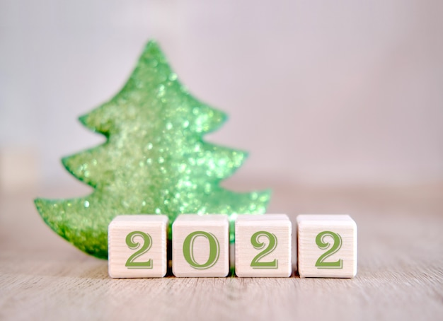 2022 christmas tree concept text words on wooden blocks.