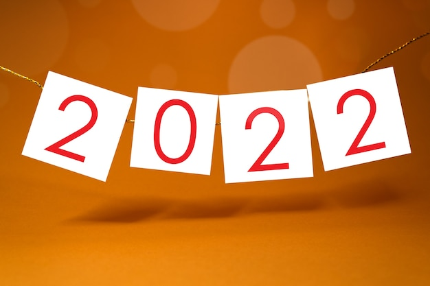 2022 happy new year template for greetings and calendars on yellow ornage background