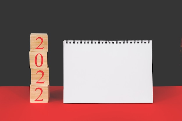 2022 is the time for a fresh start. plan and 2022 on the dice. new year. plans for 2022, place for text in notepad, calendar mockup