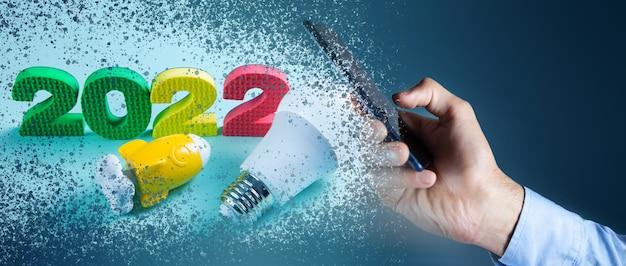 2022年の電球とロケット。コンセプトスタートアップをクリック