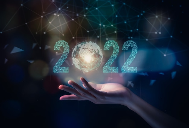 2022 and new beginning concept, hand show icon global network line, growth plan for business.