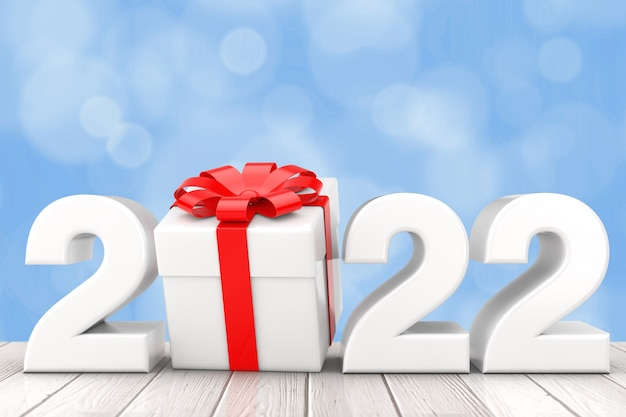 Новогодний знак 2022 года с подарочной коробкой и красной лентой на деревянном столе. 3d рендеринг