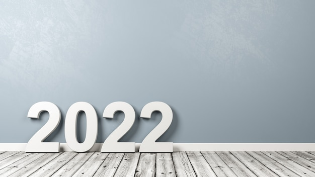 2022 number text on wooden floor against wall