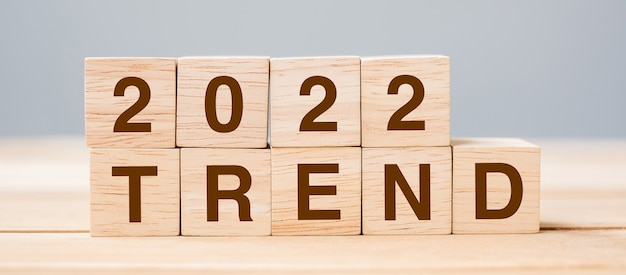 2022 trend cube block on table background. resolution, plan, review, change, start and new year holiday concepts