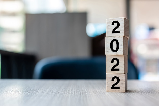 2022 wooden cube block on table background. resolution, strategy, solution, goal, business and new year new you and holiday concepts