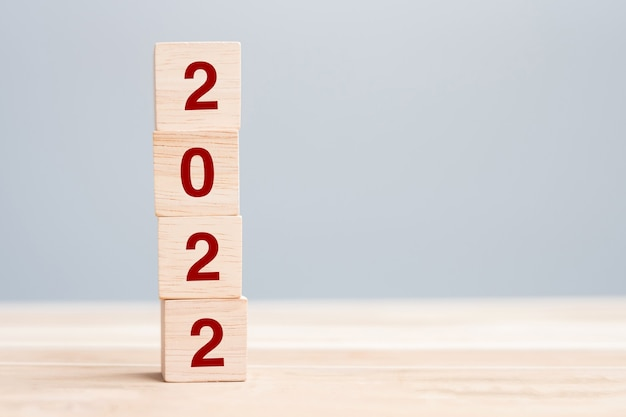 2022 wooden cube blocks on table background. resolution, plan, review, goal, start and new year holiday concepts