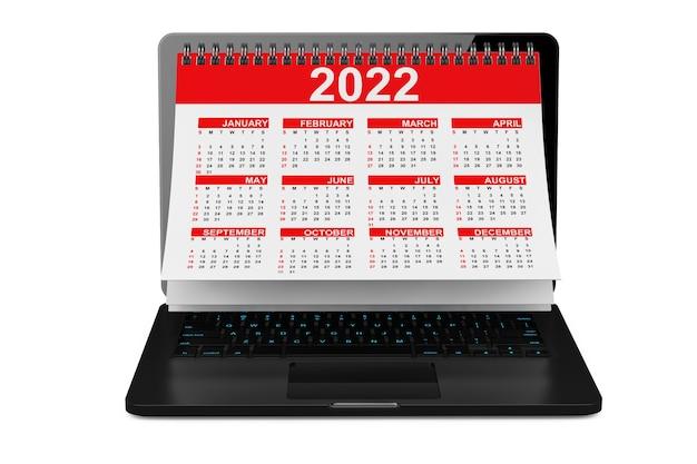 흰색 바탕에 노트북 화면을 통해 2022 년 달력. 3d 렌더링