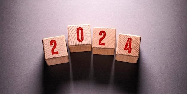 2024 word written on wooden cubes