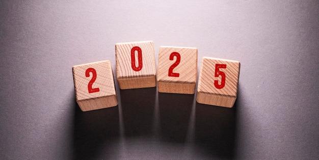 2025 word written on wooden cubes