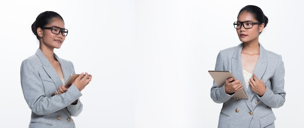 20代のアジアのビジネスウーマンスタンド正式な適切なスーツのスカートメガネ、分離されたスタジオ照明白い背景、弁護士ボス行為ポーズ笑顔スマートルックデジタルタブレット通信、グループパックコラージュ