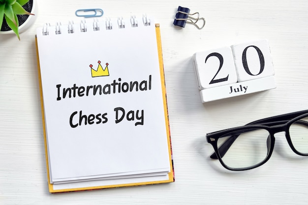 20th july international chess day - twentieth day month calendar concept on wooden blocks.