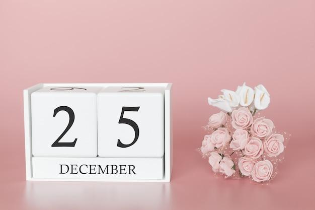 25 декабря 25 день месяца. календарный куб на современной розовой предпосылке, концепции дела и важного события.