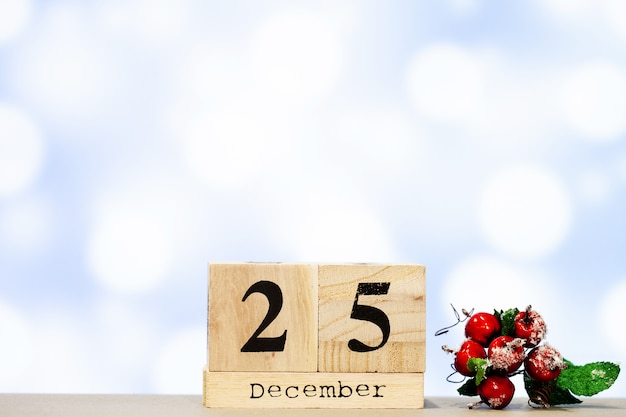 25 december and christmas decoration on blue background