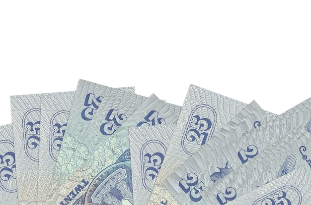 25 egyptian piastres bills lies on bottom side of screen isolated on white wall with copy space.
