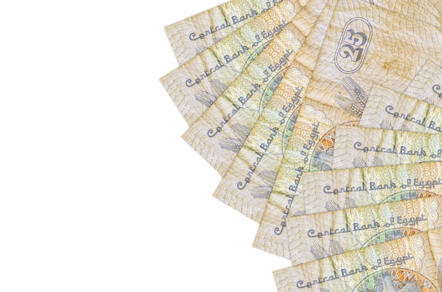 25 egyptian piastres bills lies isolated on white wall with copy space. . big amount of national currency wealth