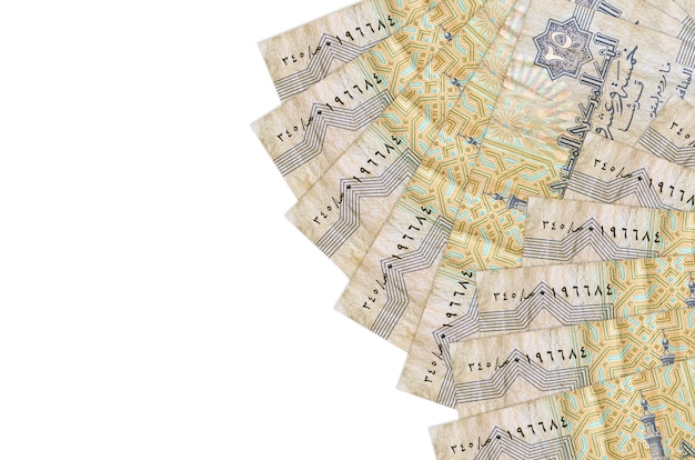 25 egyptian piastres bills lies isolated on white wall with copy space. rich life conceptual wall. big amount of national currency wealth