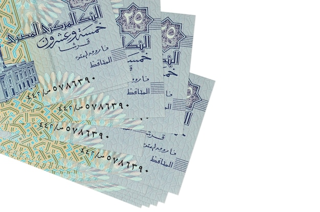 25 egyptian piastres bills lies in small bunch or pack isolated on white.  business and currency exchange concept