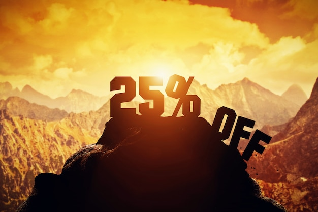 25% off writing on a mountain peak.