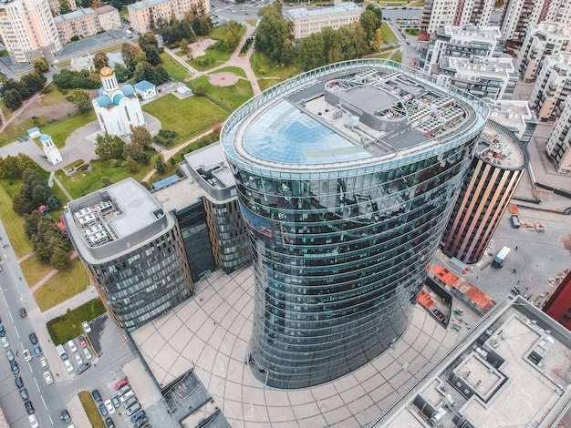 26.07.2019 st. petersburg, russia - aerial photo of a glass skyscraper business center, bank, central tower and two buildings of hotel and restaurant complex.