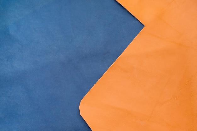 クローズアップ紺とオレンジの革は、2つのセクションを分割する、テクスチャの背景、生地部門