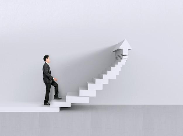 2階を歩くビジネスマン。成長チャートのコンセプト