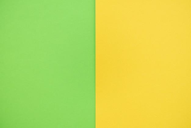 黄色と緑の2色の紙の背景。
